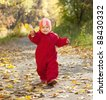 Happy toddler walking  in autumn park - stock photo
