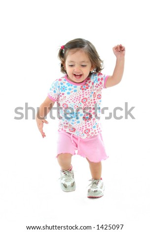 Happy toddlersmiling and dancing with a beautiful expression . More pictures of this baby at my gallery - stock photo
