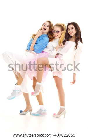 Happy together concept. three pretty girls smile on a white background . Vintage style. Fashion photo. studio photo . White background. smiling face  - stock photo