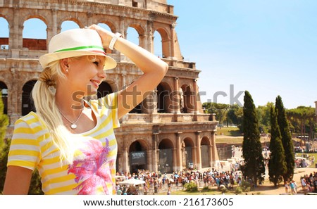 Happy Tourist and Coliseum, Rome. Cheerful Young Blonde Woman in Italy. Travel in Europe - stock photo