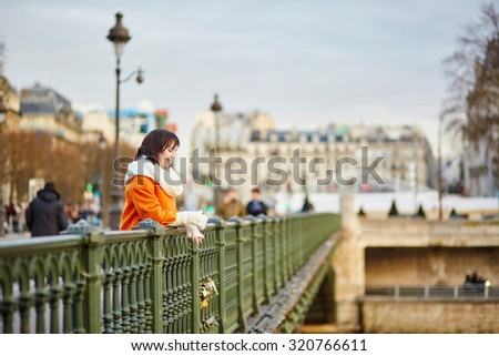 Happy tourist in Paris on a winter day - stock photo