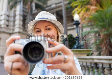 happy tourist taking photos in the city - stock photo