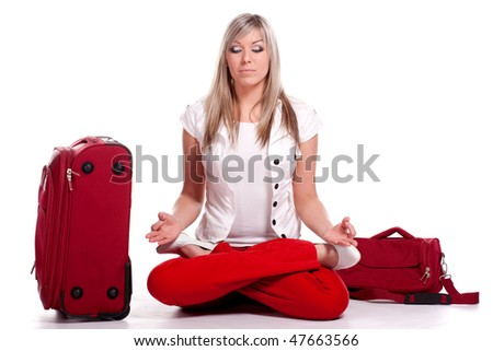 Happy tourist woman in the lotus posture.. Isolated over white background. Isolated on white background - stock photo