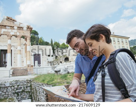 happy tourists couple in italy - stock photo