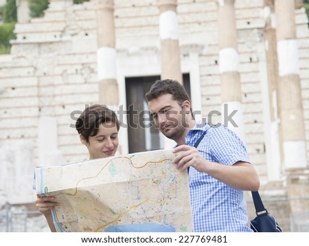 happy tourists couple in italy