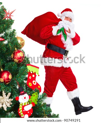 Happy traditional Santa Claus and Christmas tree.  Isolated on white background. - stock photo