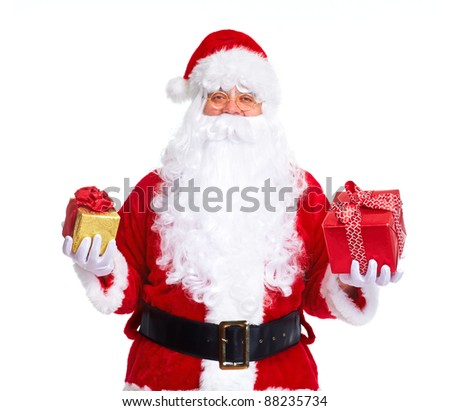 Happy traditional Santa Claus with Christmas gifts. Isolated on white background. - stock photo