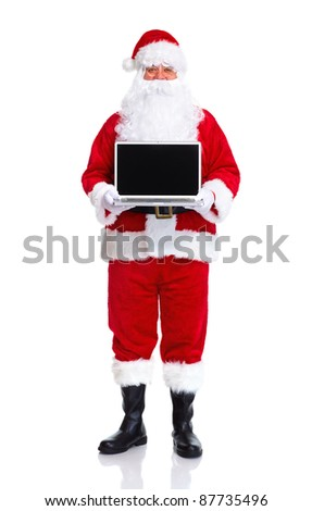 Happy traditional Santa Claus with laptop computer. Christmas. Isolated on white background. - stock photo