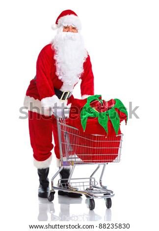 Happy traditional Santa Claus with shopping cart. Christmas. Isolated on white background. - stock photo