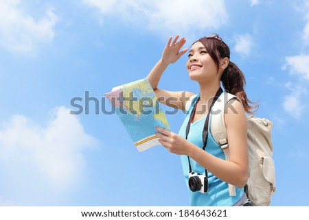 Happy travel woman look map and look copy space with sky background, asian - stock photo