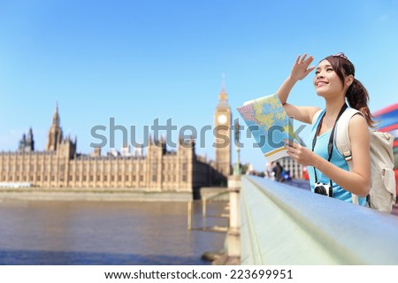 Happy travel woman look map in London with Big Ben tower,  London, UK,  asian beauty - stock photo