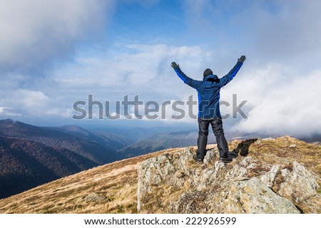 Happy traveler and clouds in mountains