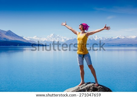 Happy traveler enjoy sunny day near the Pukaki lake. New Zealand - stock photo