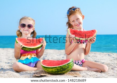 Happy two children of the sea with watermelon - stock photo