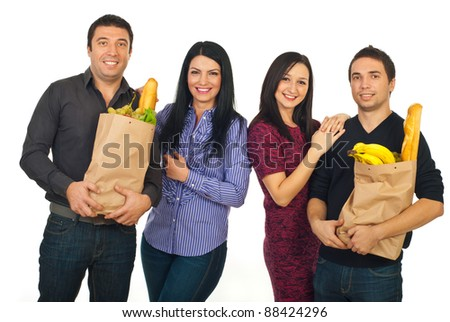 Happy two couples at shopping for food isolated on white background