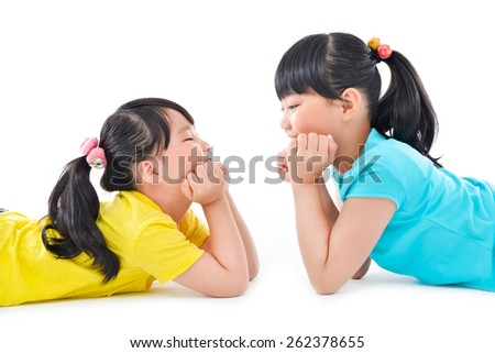 happy two little girls on the white background - stock photo