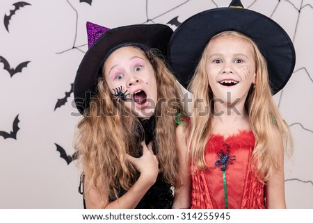 Happy  two sisters on Halloween party - stock photo