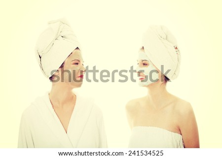 Happy two young woman with anti-aging masks . - stock photo