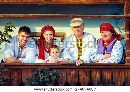 happy ukrainian family on the wooden porch - stock photo