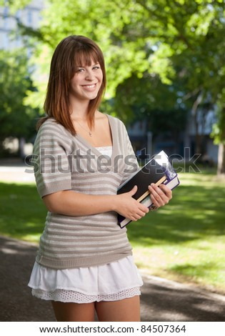 Happy university student looking at the camera - stock photo
