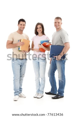 Happy university students standing with books and notes handheld, smiling at camera, cutout.?
