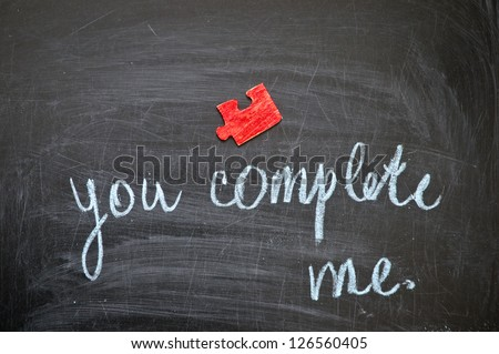"Happy valentine, inscription by hand chalk ""you complete me."" - stock photo"