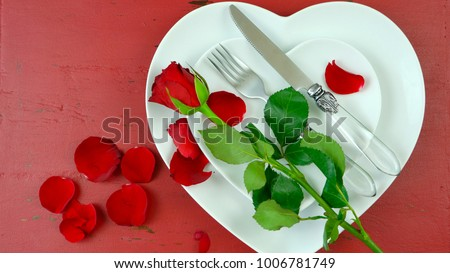 Happy Valentine's Day overhead with heart shaped plates and roses table place setting.