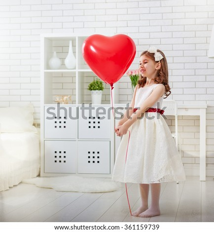Happy Valentine's Day! Sweet child girl with red heart.