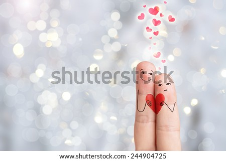 Happy Valentine's Day theme series. Lovers is embracing and holding heart. Stock Image. Finger art of a Happy couple.  - stock photo