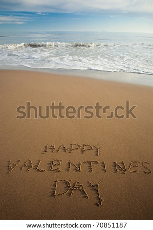 Happy Valentine`s day  written in sand on a beach - stock photo