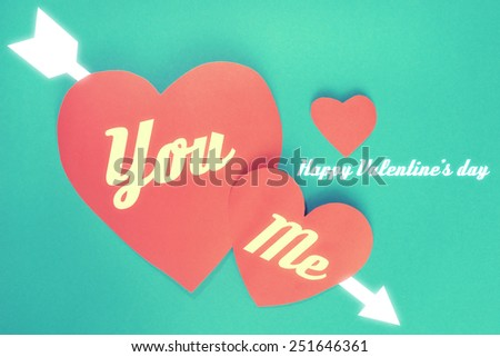 Happy Valentine's day You Me and arrow on red hearts paper on cyan paper background - vintage tone