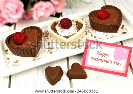 Happy Valentines card with heart shaped chocolate dessert cups  - stock photo
