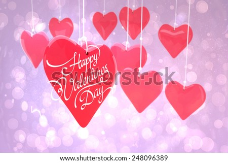 happy valentines day against purple abstract light spot design