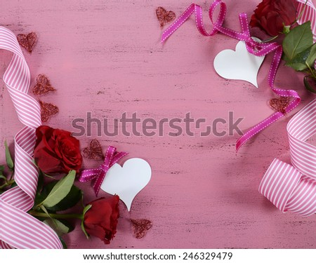 Happy Valentines Day background with red roses, ribbons and heart decorations with copy space. - stock photo