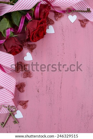 Happy Valentines Day background with red roses, ribbons and heart decorations with copy space, vertical. - stock photo