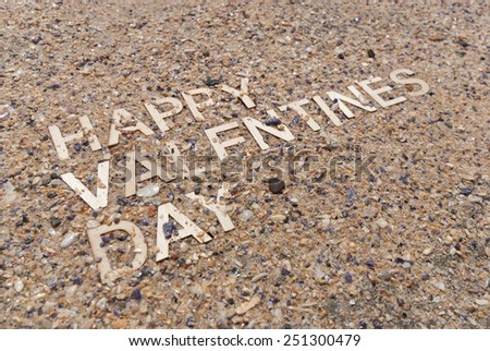 Happy Valentines Day concept made up with wooden letters on maritime pebble background. - stock photo