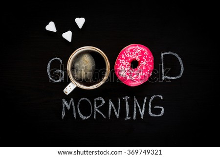 Happy Valentines Day Food. Donut, cup of coffee and heart shaped sugar cubes. Good morning greeting written on black chalk board. Table top view. - stock photo