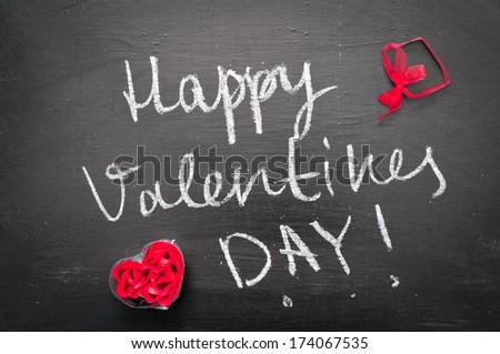 Happy Valentines day/handwritten on school blackboard - stock photo