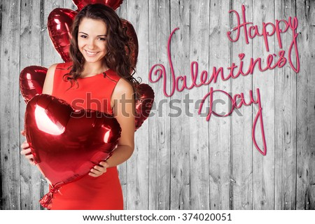 Happy Valentines Day on a gray wooden wall - stock photo