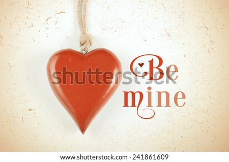 Happy Valentines Day retro vintage grunge style hanging red wood heart with Be Mine sample text greeting message. - stock photo