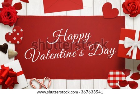 Happy Valentines Day scene with gifts, hearts, petals, rose, lollipop, tablecloth on wooden table. - stock photo