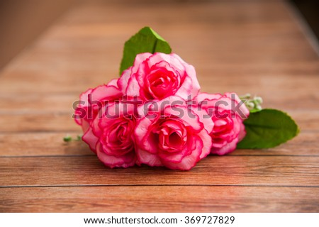 Happy Valentines Day, Special day, Birthday, Anniversary. Roses on wood background and center of frame.Bouquet for special person. - stock photo
