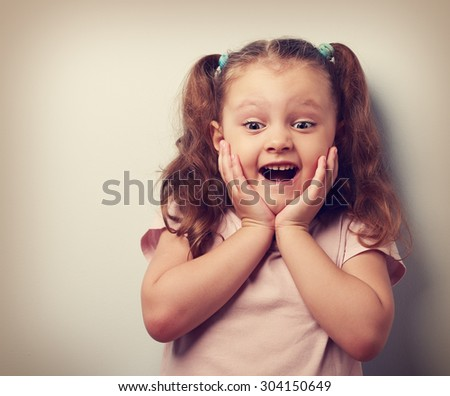 Happy very excited kid girl with open mouth looking. Closeup vintage portrait - stock photo