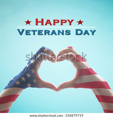Happy Veterans day text message with American US flag pattern on people hands in heart shape form isolated on vintage blue sky background: United states of america - USA national holiday concept  - stock photo