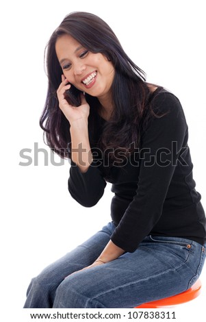 Happy Vietnamese woman talking on her cell phone isolated on white - stock photo