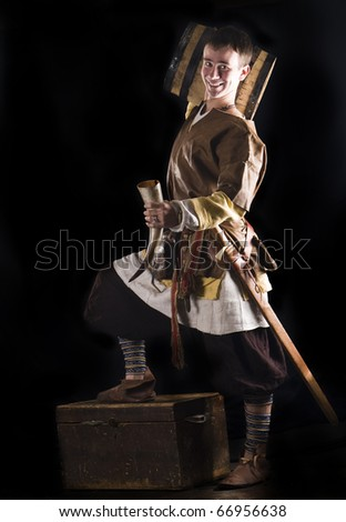 Happy viking with beer barrel - stock photo