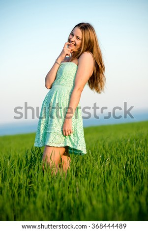 Happy vitality freedom girl stands with her hands. Playfull woman - stock photo