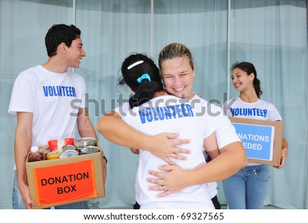 happy volunteer group with food donation boxes