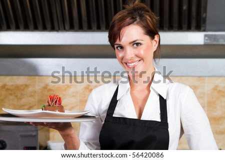 happy waitress holding plate of dessert - stock photo