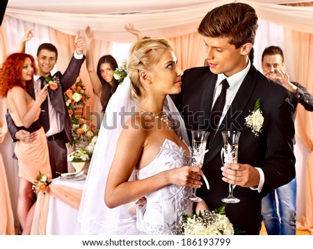Happy wedding couple drinking champagne.